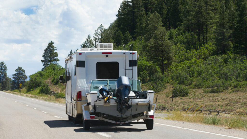 An RV is towing a boat and together these can affect the cost of the insurance!