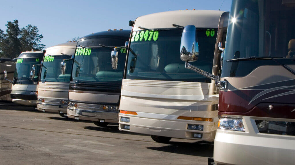 A row of RVs for sale, but is 2021 the worst year to buy an RV?