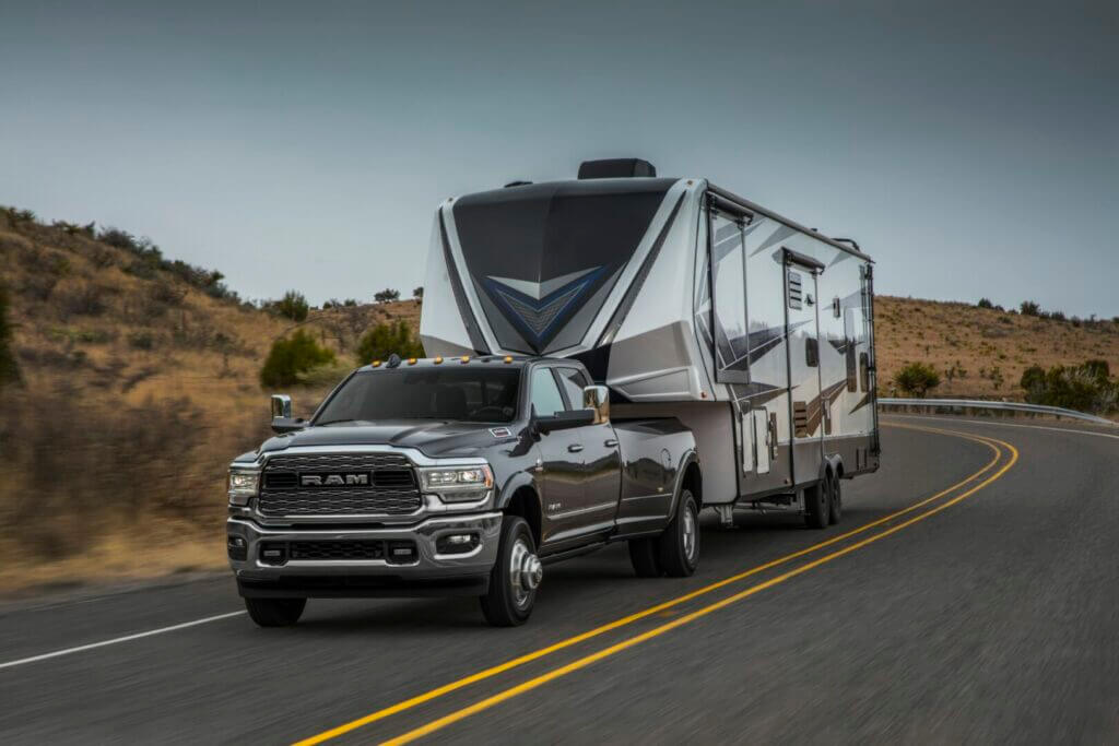 Is the Ram 3500 the best truck for towing your RV? This picture is a Ram 3500 towing a fifth wheel down a desert highway.