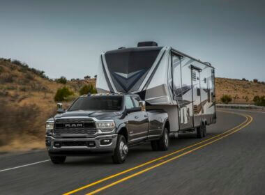 Ram 3500 vs Ram 2500, which one is better for towing your RV? This picture is a Ram 3500 towing a fifth wheel down a desert highway.