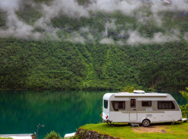 A trailer is left alone unhitched in a beautiful green area near a lake. Is it safe from thieves by being secured with an RV trailer hitch lock?