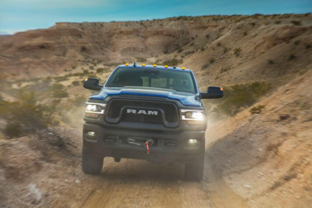 2021 Ram Power Wagon Crew Cab driving up a dirt road