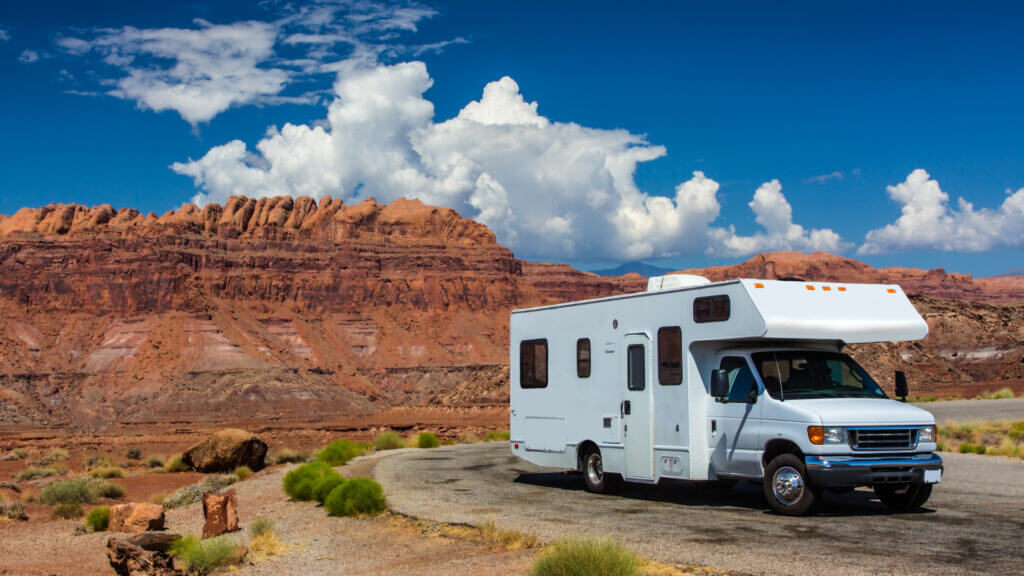 An RV is pulled off the road in the desert. If you wanted to rent one for a vacation, how much does it cost to rent an RV?
