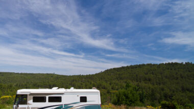 A large RV is ready to boondock in the gorgeous green mountains! Even better if they're prepared with the best boondocking tips for a big rv!