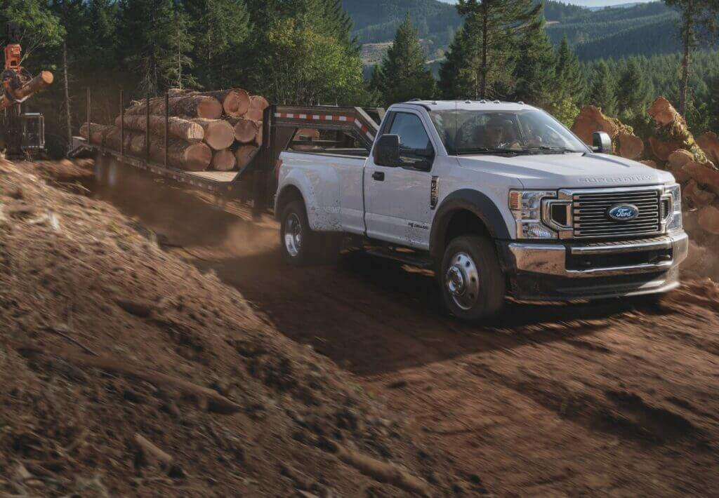 A Ford F 450 Super Duty truck can tow logs and tow an RV.