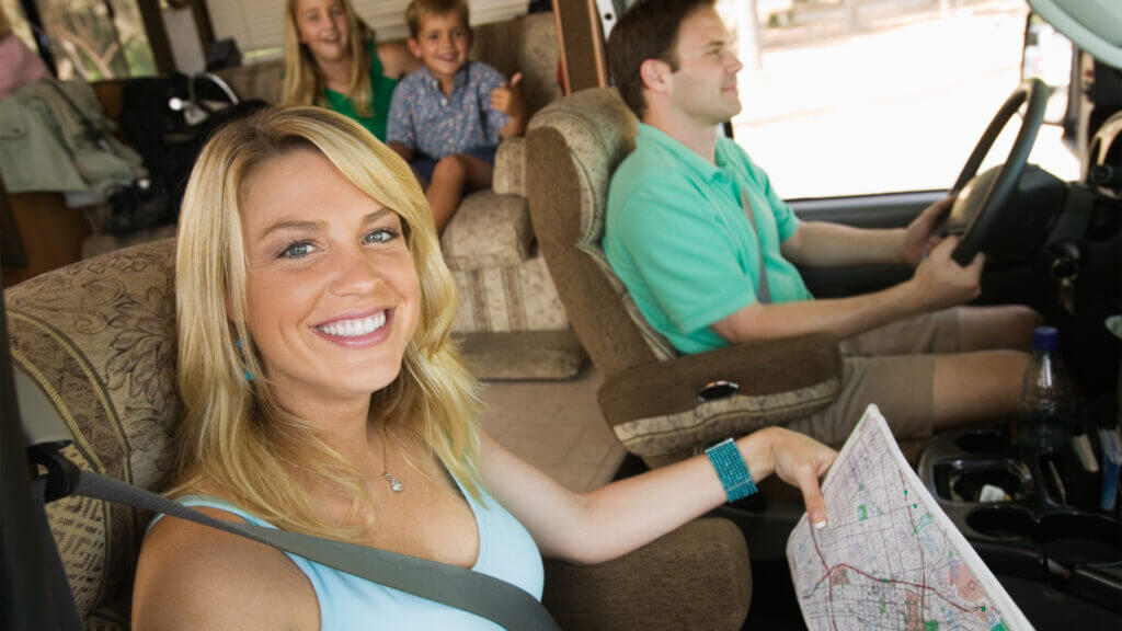 A family is ready for their road trip in a rented RV.