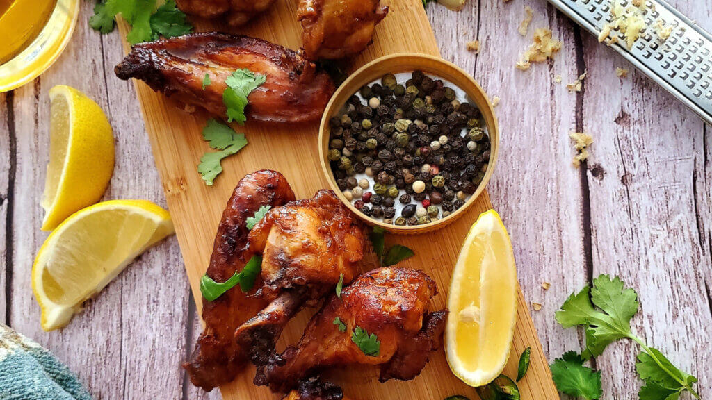 A unique campfire lunch that's perfect for a summer camping trip is blackberry chicken with some lemon and pepper. Yum!
