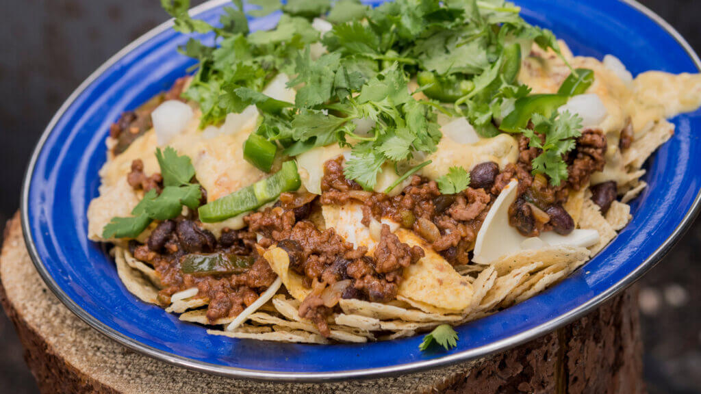 Campfire nachos are always a hit and an easy camping lunch.