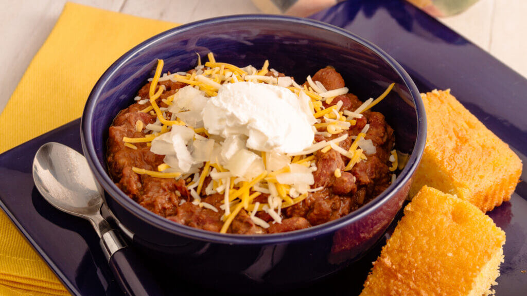 On a campfire or not, dutch oven chili and corn bread is a delicious pairing.
