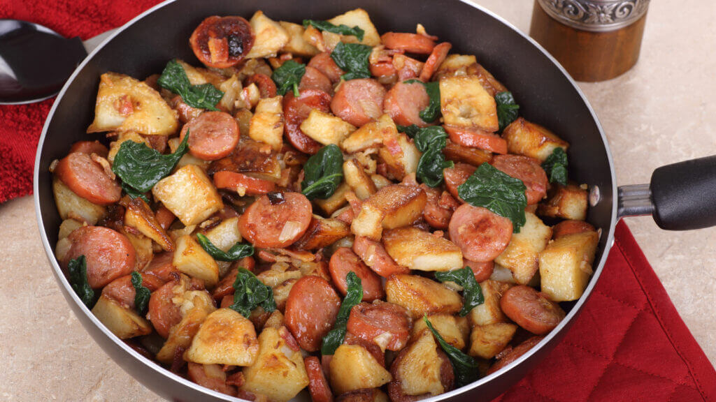 An easy campfire lunch by simply heating up in a skillet is kielbasa and potatoes.
