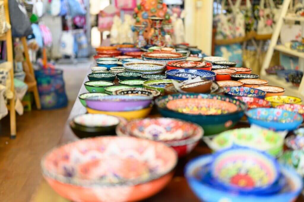 A row of colorful bowls in a souvenir shop. One of our unique rv decorating ideas is to use what you find on your travels.