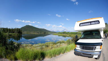 An RV is parked near a lake and ready for a boondocking trip. What is a freshwater rv tank and is their's full and ready for the trip?
