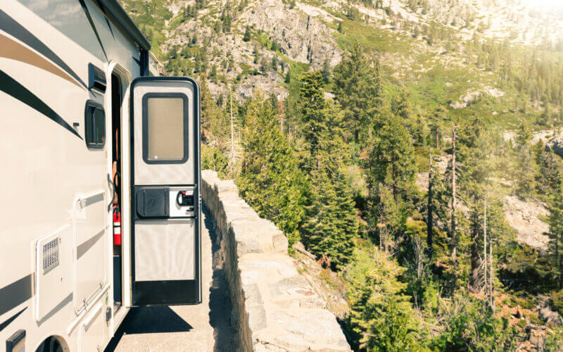 An RV door is open as theyve pulled off to the side of the road and they dont have to worry about getting locked out with the RVLock keyless entry.