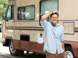 A man stands in front of his RV and feels the pain of his thousand trails membership regrets