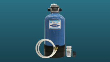 An on the go water softener set against a blue background