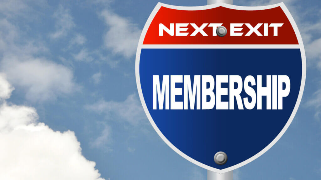 A sign says next exit membership. Memberships can help save a lot of money on the road RVing.