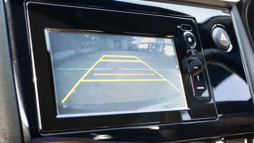 A backup camera can make reversing an RV into a driveway much easier.