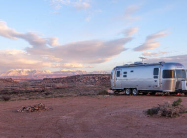 A silver airstream is the ultimate off-grid RV with these top 5 upgrades! It can stay camped out in the desert for much longer than most RVs.