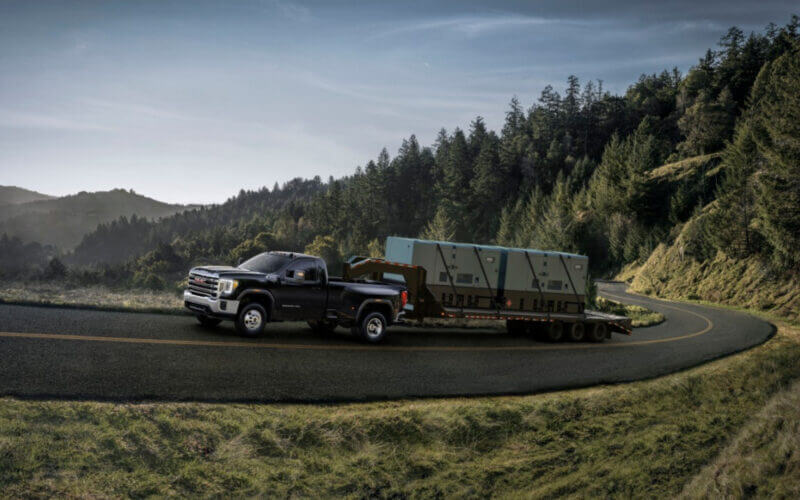 A 3500 truck tows a large trailer up a winding mountain road. Which is the best 3500 truck?