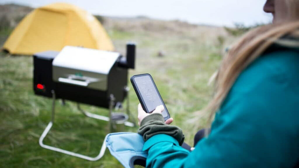 A Green Mountain Grill has bluetooth communication with your phone so you can ensure your food is cooked at the perfect temperature while camping.
