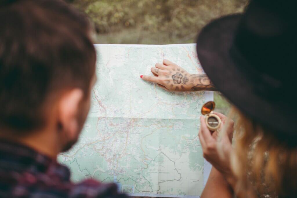 A couple looking at a map and planning their RV trip to florida keys.