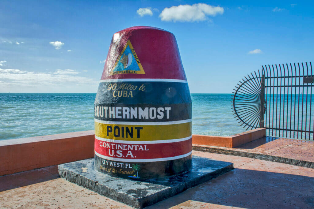 a large painted cement block that says it's the southernmost point in the US.