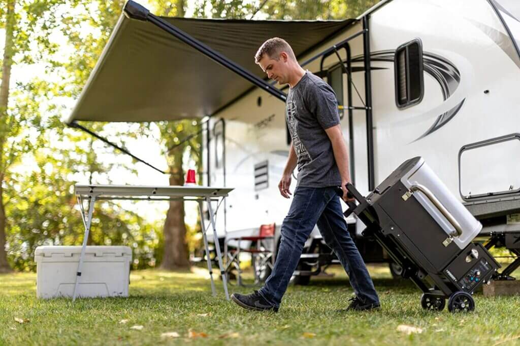 Camp Chef Pursuit folded up and rolling through an RV site