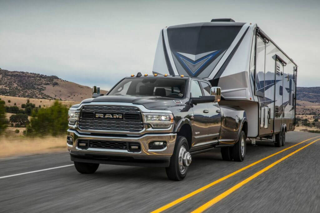 A Ram 3500 Heavy Duty Dually truck tows a fifth wheel easily on a highway.