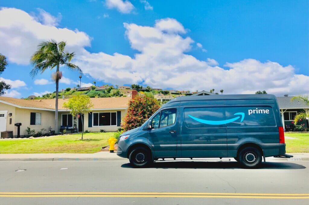 Amazon van parked in front of a house