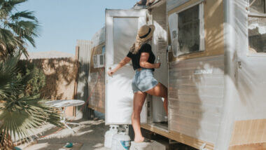A blonde woman enters an RV but she doesn't have to worry about getting locked out with a Keyless RV lock.