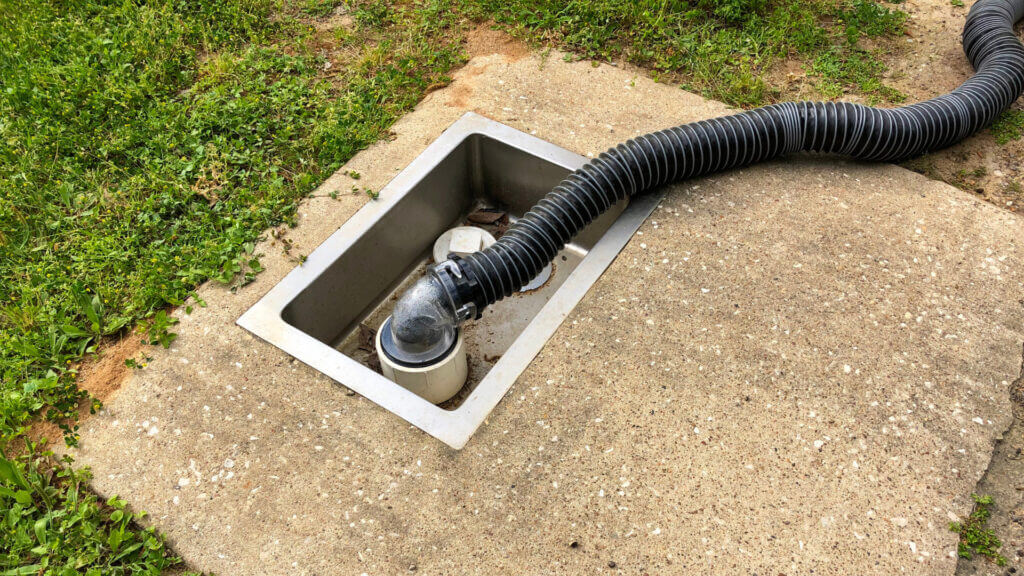 A black sewer hose is used to dump the black tank and if they use an RV macerator pump it will be mess and clog free.