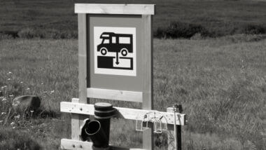 A black and white dump station sign and there are lots of resources to help you find a dump station for free!