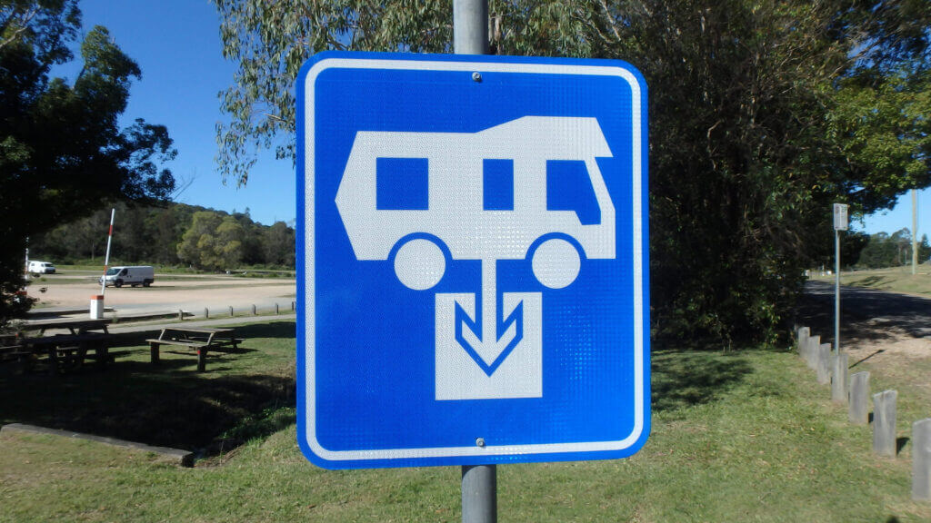 A blue RV dump station sign and can be a useful tool to finding a free dump station.