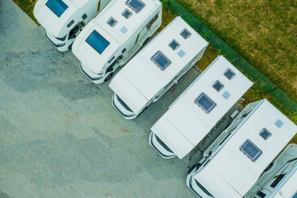 Drone shot of camper vans in a row on a dealership lot