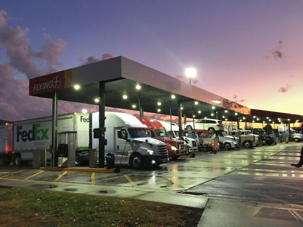 Trucks lined up at the pumps at a Flying J station. The gas prices are a common good sam regrets