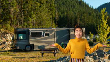 A woman stands in front of her RV with confusion because she made some common RV setup mistakes.