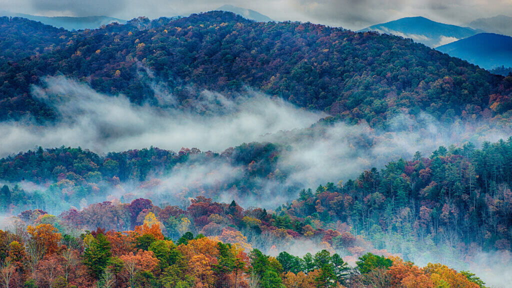 A colorful scene of trees and clouds in the Smoky Mountains, TN.