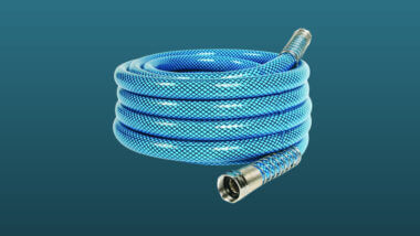 A camco water hose set against a dark blue background.