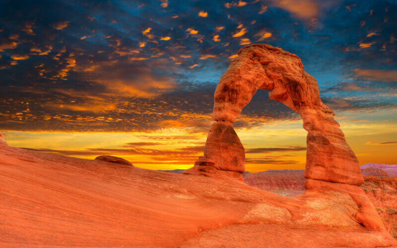 Arches national park glow orange in the sunset light and it's a sight you can see if you plan an RV trip to Utah.