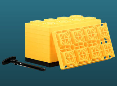 Yellow Camco leveling blocks set against a blue background.