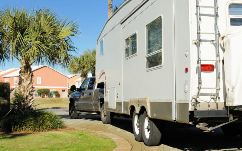 A truck reverses their RV into the driveway without anxiety
