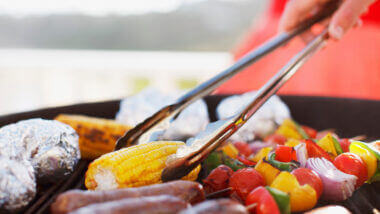 Someone is flipping veggies on a grill but which is better? Green mountain grills vs Traeger?