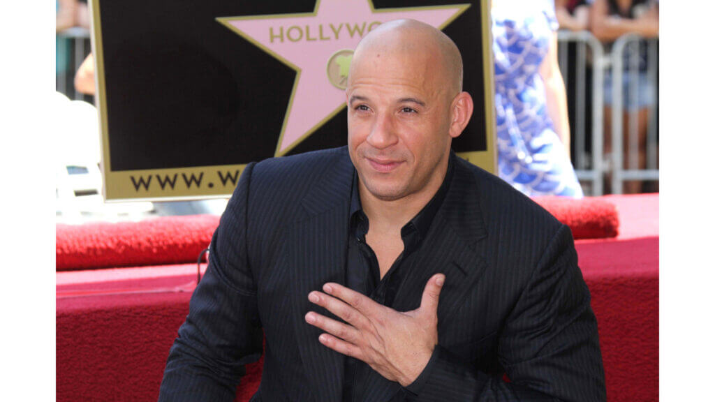 Vin Diesel looks proud at a film event but he escapes the set life in his celebrity RV.