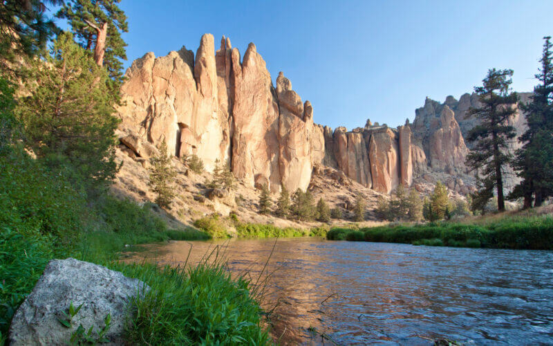 The sun reflects off Smith Rock and across the Deschutes River just north of Bend, OR where you can find some great RV camping spots.