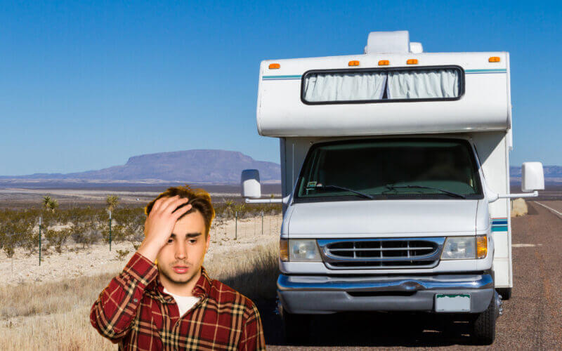 A man stands in front of his RV and regrets investing money into an FMCA membership.