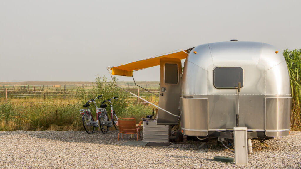 A travel trailer is a good option for living in because you still have a vehicle to drive around and explore once you've set up camp.