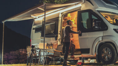 A man steps into a lit Class B RV which could be a great RV to live in full time.