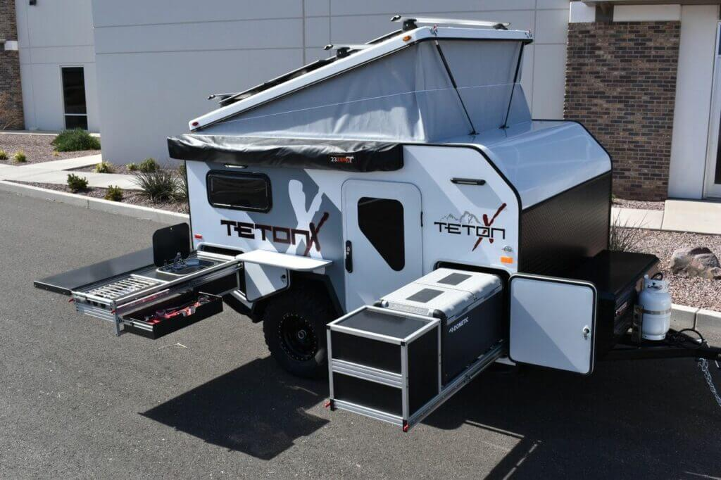 An off-road trailer all setup in the parking lot to show off it's features
