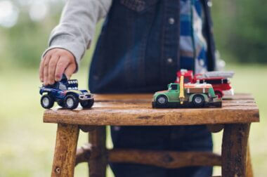 kid playing with toy trucks