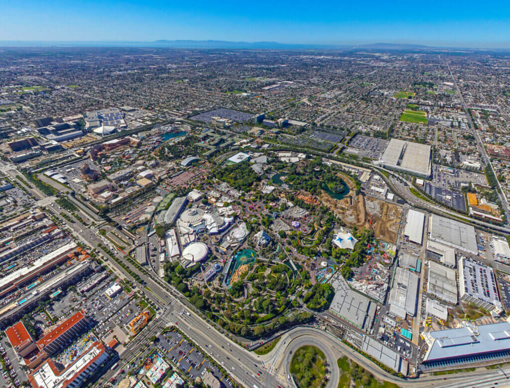 Aerial shot of Disneyland in Anaheim, CA showing the entire park and the surrounding city. You'll want to stay close to the park when planning your RV Trip To Disneyland
